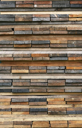 stack of wooden planks new and old photo