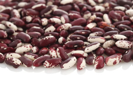 Raw Organic cranberry bean on white background. photo