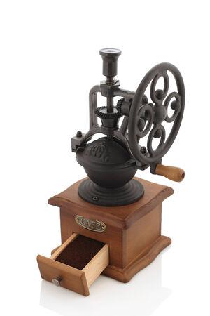 młynek do kawy: Vintage coffee grinder isolate on white background Zdjęcie Seryjne