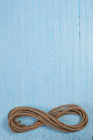 twisted rope on blue wooden boards photo