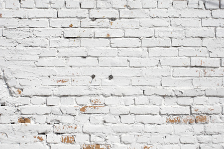 disruption: Old brick wall painted with white paint. background texture