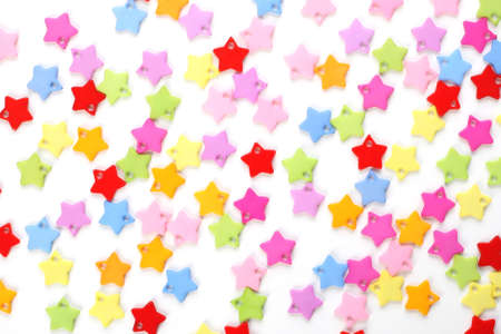 blowers: colored stars confetti on white background