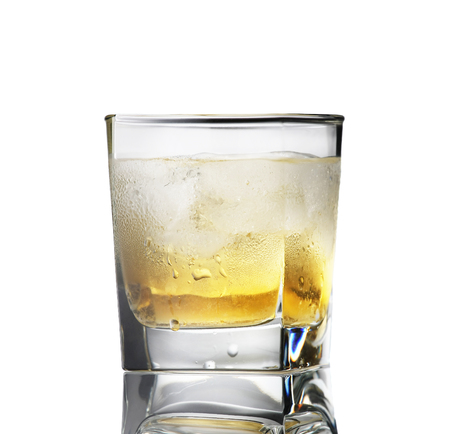 temperance: whiskey with ice in a sweaty glass on a white background isolate
