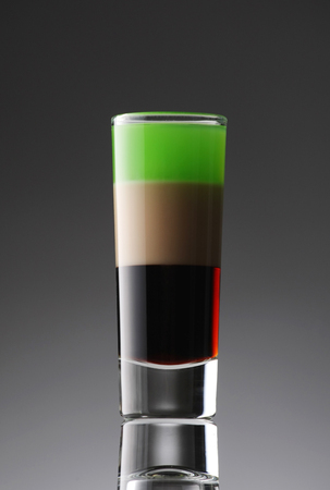 shooters: alcoholic cocktail in a glass (arrow) on the gradient background
