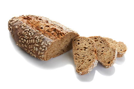 a loaf of unleavened bread with sunflower seeds close-up on a white background, isolate Stock Photo