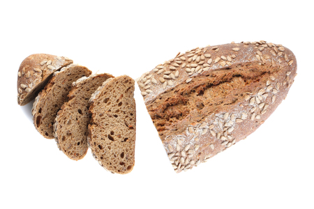 A loaf of unleavened bread with sunflower seeds close-up on a white background, isolate
