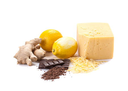 ginger, lemon, cheese, grated cheese, chocolate, grated chocolate on a white background, isolate