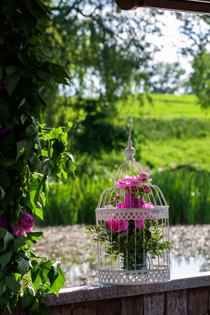 cage with beautiful flowers outdoors in the gazebo