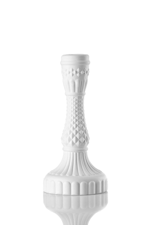 white candlestick, plaster close up isolate on a white background