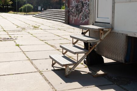 metal steps coated with aluminum sheet attached to the van