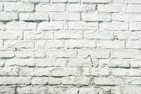 old brick wall painted with white paint