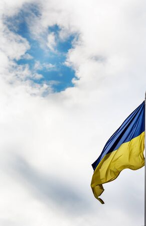 emblem of ukraine: Ukrainian flag and cloudy sky