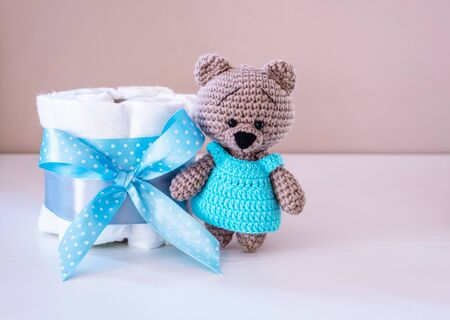 Present cake with diapers for newborn baby boy with little teddy