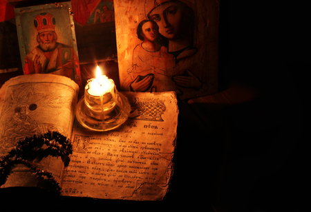 commandment: The religious book with icons and candles Stock Photo
