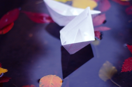 Autumn scene with paper boats Stock Photo