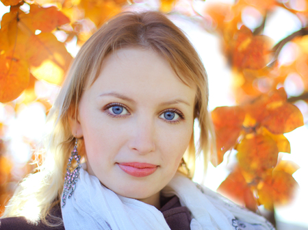 Portrait of a woman on the background of autumn leaves Stock Photo