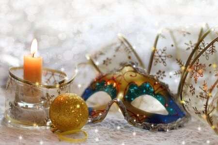 bead embroidery: Christmas still life with mask, ribbons, balls and candles Stock Photo