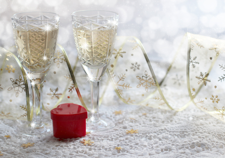 Christmas composition with wine glasses and a gift