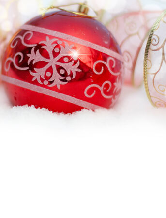 Christmas background with Christmas toys in the snow Stock Photo