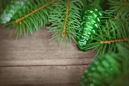 Christmas background with fir-tree branches with cones