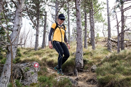 A woman hiker backtracking. National park Paklenica, the part of Velebit; the largest mountain range in Croatia.