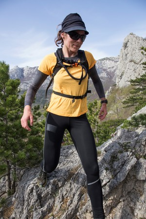 A woman hiking on a gravel. National park Paklenica, the part of Velebit; the largest mountain range in Croatia.