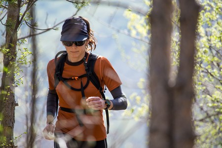 A woman hiker with sports equipment running. National park Paklenica, the part of Velebit; the largest mountain range in Croatia.