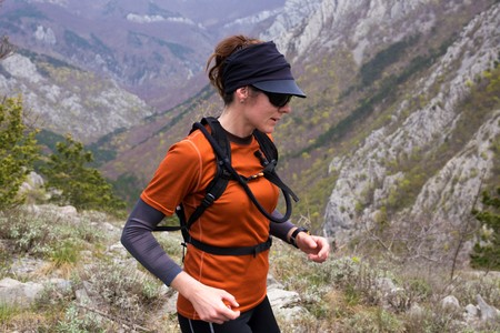 A woman hiker in the rocky mountains. National park Paklenica, the part of Velebit; the largest mountain range in Croatia.