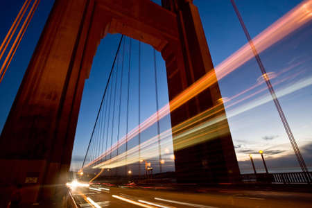 suspension bridge: Long exposure of cars passing through one of the towers of the Golden Gate Bridge. Shot in San Francisco.