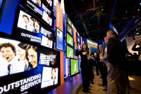 tradeshow: LAS VEGAS - JANUARY 8, 2009: People are looking at an impressive wall of TVs at the 2009 Consumer Electronic Show held in Las Vegas, Nevada, on January 8, 2009.