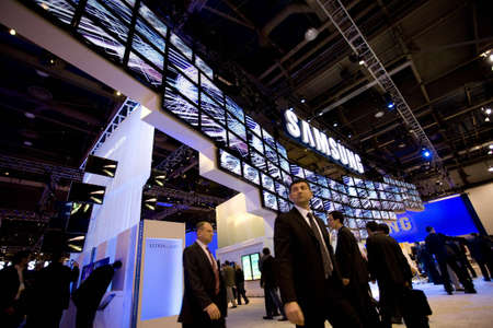 LAS VEGAS - JANUARY 8, 2009: People are walking under a large display of TVs at the 2009 Consumer Electronic Show held in Las Vegas, Nevada, on January 8, 2009. Stock Photo - 6884699