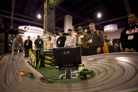 LAS VEGAS - JANUARY 8, 2009: spectators are racing toy cars at the 2009 Consumer Electronic Show held in Las Vegas, Nevada, on January 8, 2009.