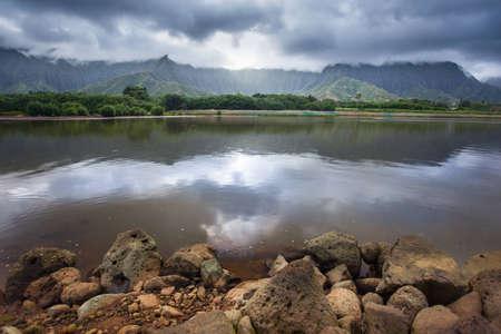 Sun shines through the mist of the Koolau Mountain Range in this Hawaiian scenic