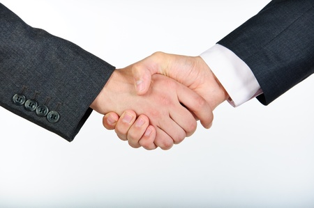 staffing: Closeup picture of businesspeople shaking hands, making an agreement.