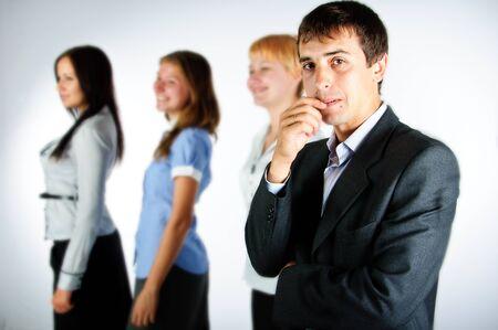 subordinates: businessman standing against the background of his subordinates