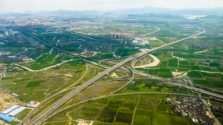 interchange: Aerial view of Jiangshan North Interchange and suburban landscape, Ningbo