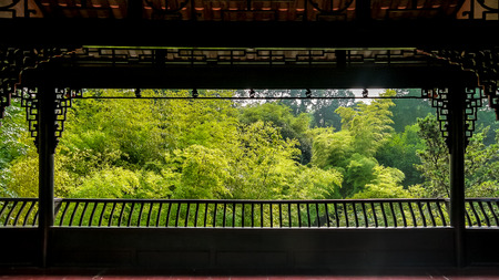 fretwork: A Chinese pavilion with a view of bamboo grove