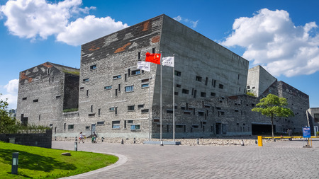 shu: Exterior of Ningbo Museum in blue sky, designed by Wang Shu