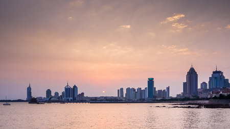 cirrostratus: Sunset urban skyline of western part in Shinan district, Qingdao