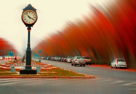print: Artistic view of a vintage clock from bucharest in a autumnal season with trees time tunnel effect Stock Photo