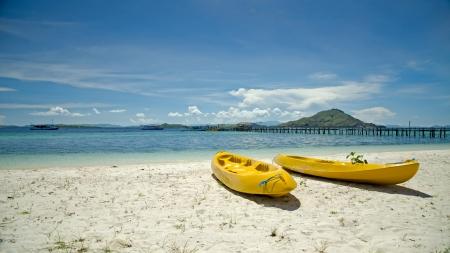 Two yellow canoe on the sandy beach  Indonesia  Kanawa  Stock Photo