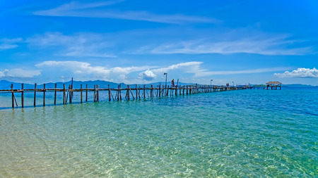 berth: Wooden pier stretching out to sea Stock Photo