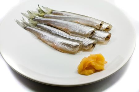 white salmon river: freh small scale fish with caviar on white plate