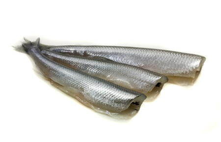 freh small scale fish without head on white background