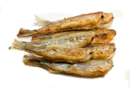 fried small smelt fish on white background
