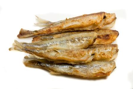 fried small smelt fish on white background