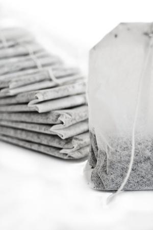 Lots of tea-bags arrange on white