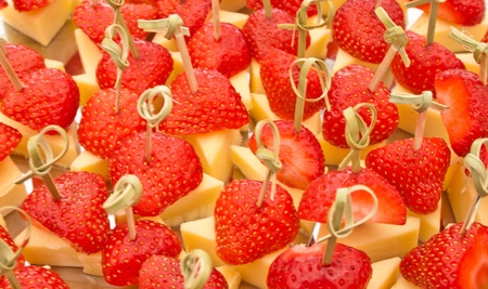 chees: canape from strawberry with chees on skewer Stock Photo