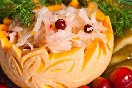 sauerkraut with red cowberry in art pumpkin