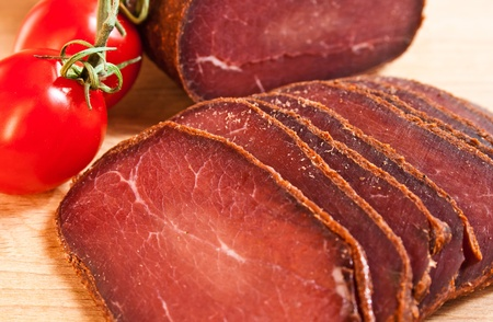 meat delicious basturma on wood with cherry